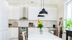 V kuchyních vládnou moderní bezúchytková dvířka Foto: