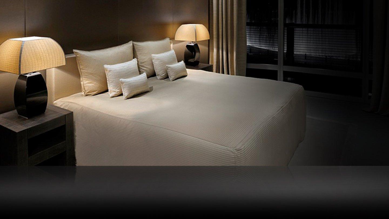 """. V pokoji Classic (535 €, 70 m2) spočine váš iPod ve stanici Bose a vy na posteli """"king size"""""""