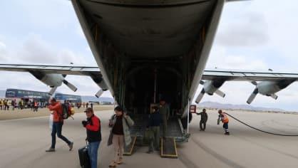 Novináře přepravují vojenská letadla